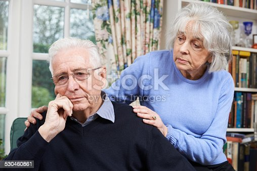 874789476istockphoto Woman Comforting Senior Man With Depression 530460861