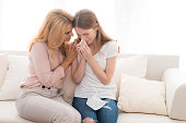 istock A woman comforts a teenage daughter. 897429198