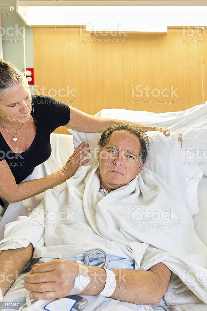 Woman comforts her husband in the hospital royalty-free stock photo