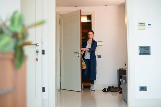 Woman coming home after grocery shopping stock photo