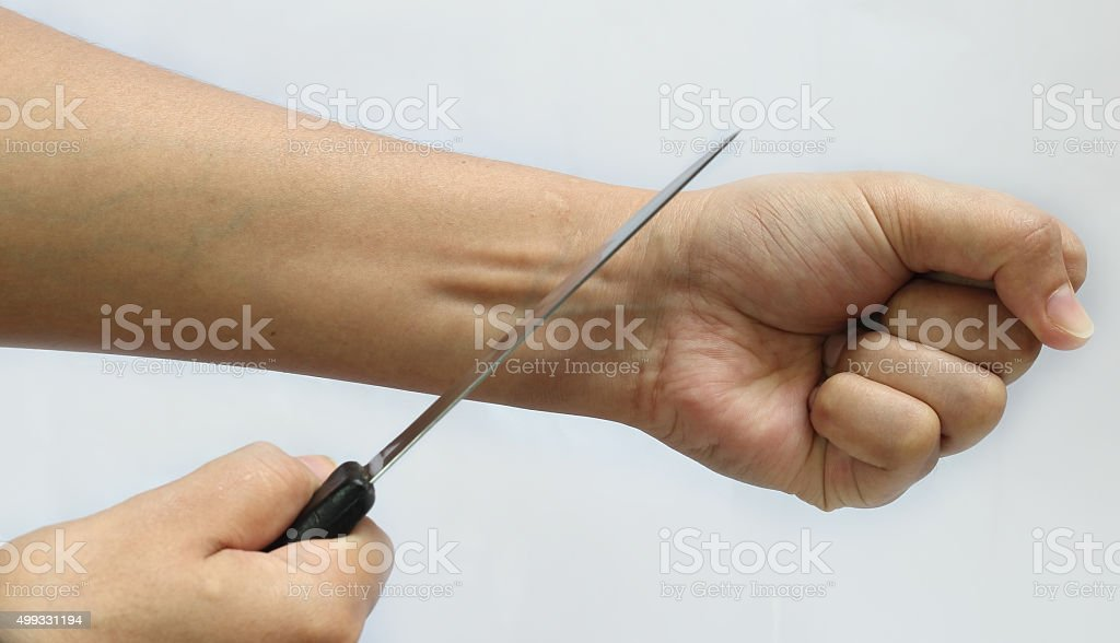 woman commit suicide by knife stock photo