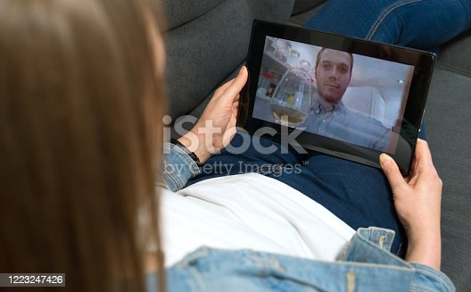 Woman communicate with man. Drink party via video call. Home quarantine.