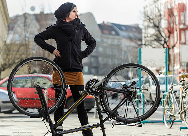 Woman Commuter with a Flat Tire on Her Bicycle