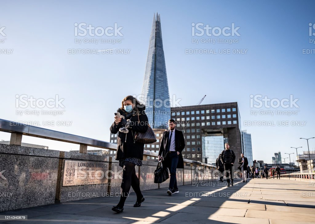 Woman Commutes To Work On London Bridge With Protective Face Mask Stock Photo Download Image Now Istock