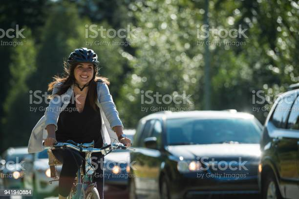Woman commuting in a cycling lane picture id941940884?b=1&k=6&m=941940884&s=612x612&h=slkvuj7je3qo2nizduyvp7blkeghiotooqiud9yptym=