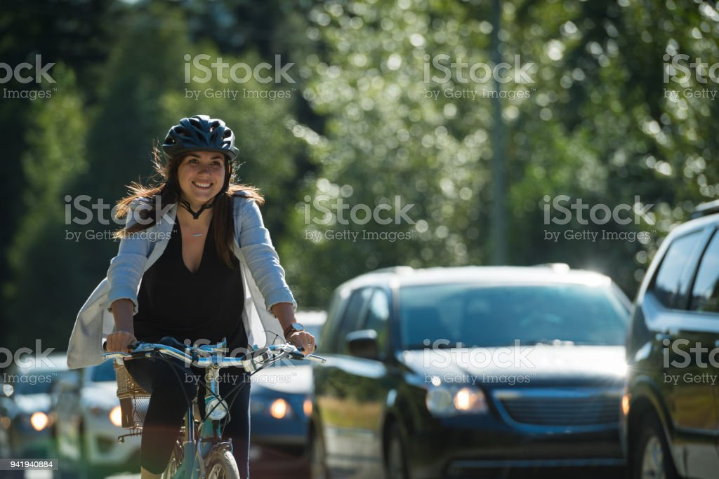 Woman commuting in a cycling lane stock photo