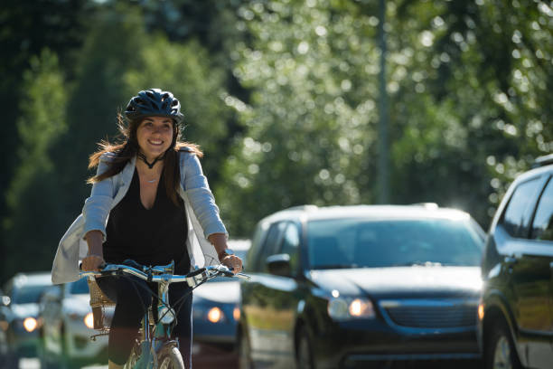 woman commuting in a cycling lane - cycling stock photos and pictures