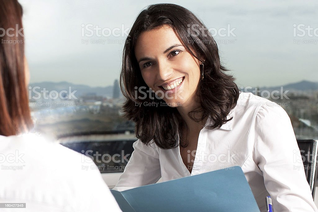 A woman conducting a job interview stock photo