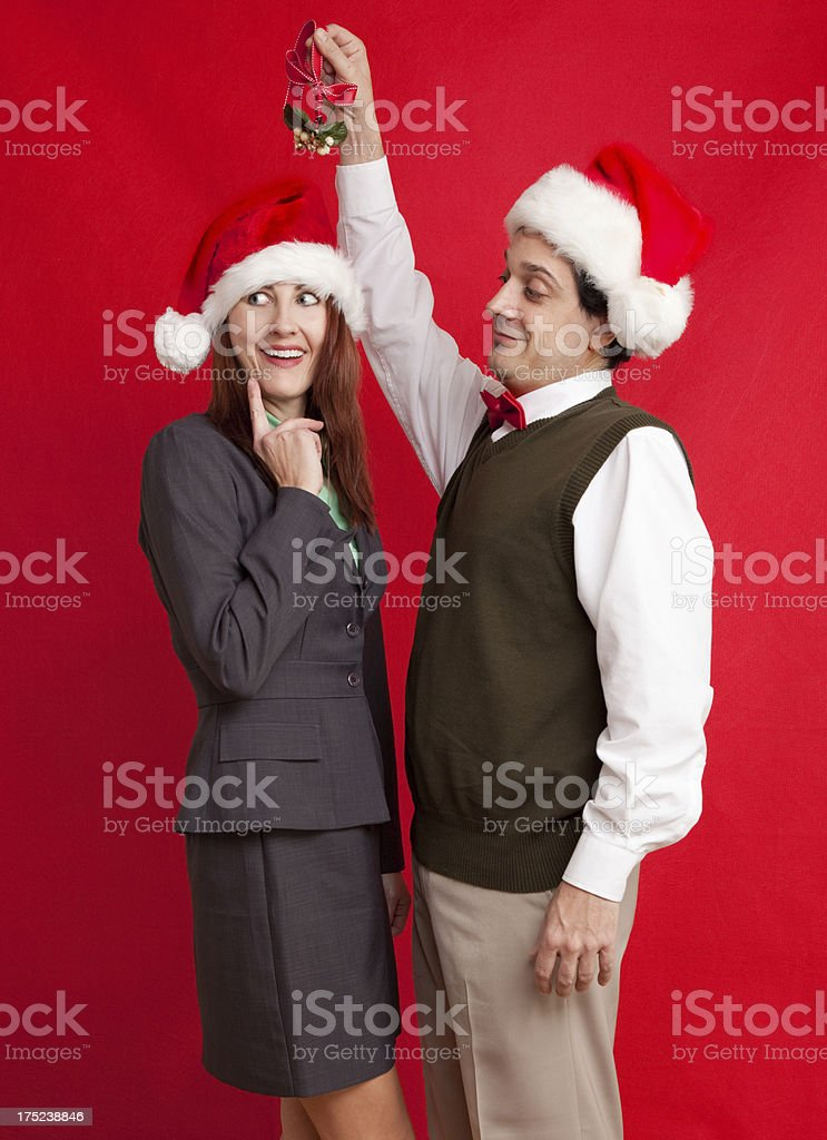 Woman Considering Kiss Under Mistletoe royalty-free stock photo