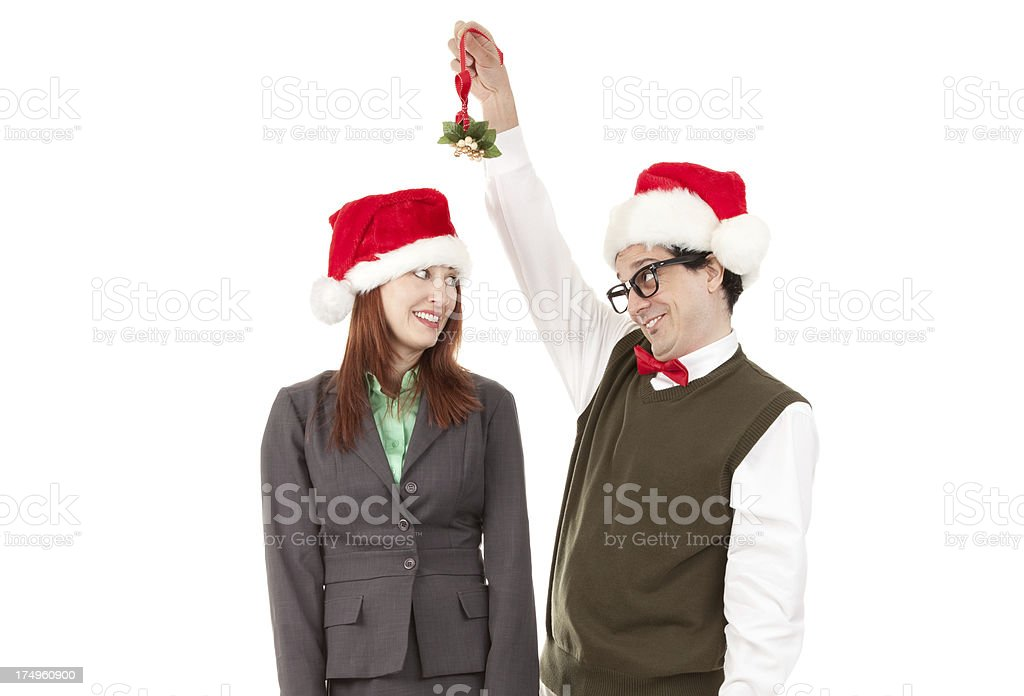 Woman Considering Kissing Nerd With Mistletoe royalty-free stock photo