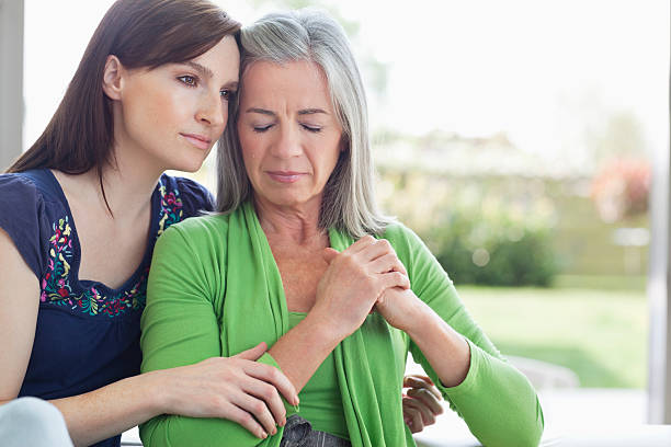 woman consoling sad mother - grief stock photos and pictures
