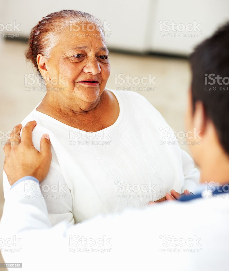 Woman consulting a doctor royalty-free stock photo