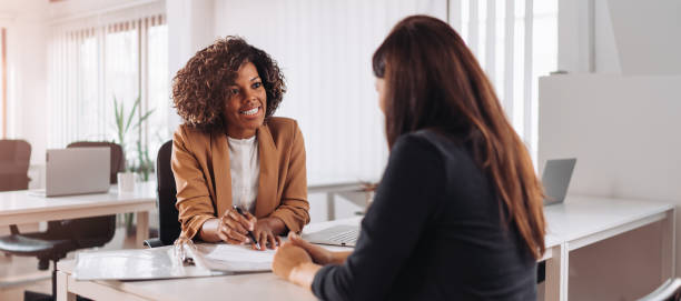 Woman consulting with a female financial manager at the bank stock photo