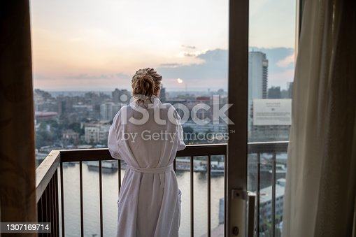 Woman enjoys sunset by the Nile river, Egypt