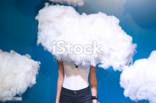istock Woman Contemplation at clouds on background 1010177068