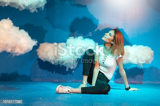 istock Woman Contemplation at clouds on background 1010177082