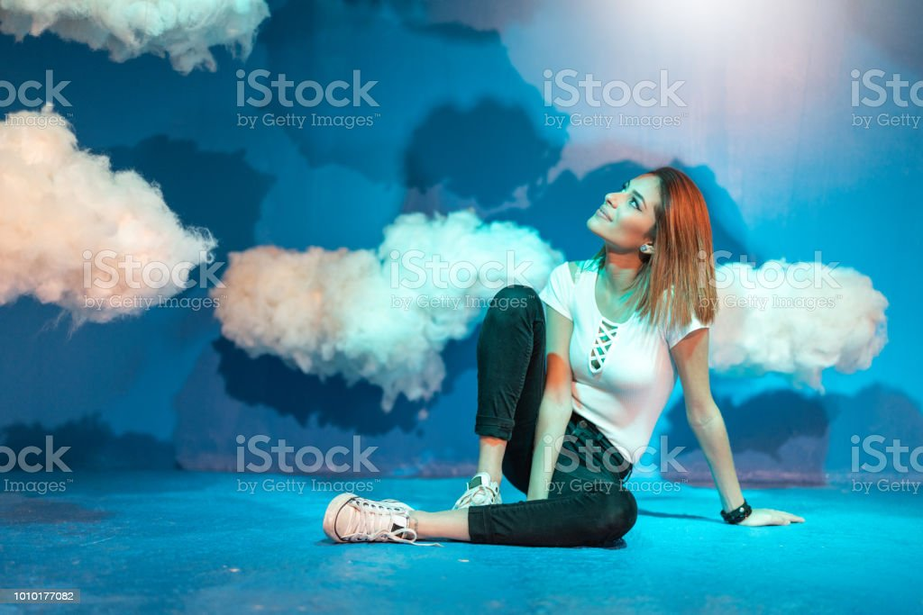 Woman Contemplation at clouds on background stock photo