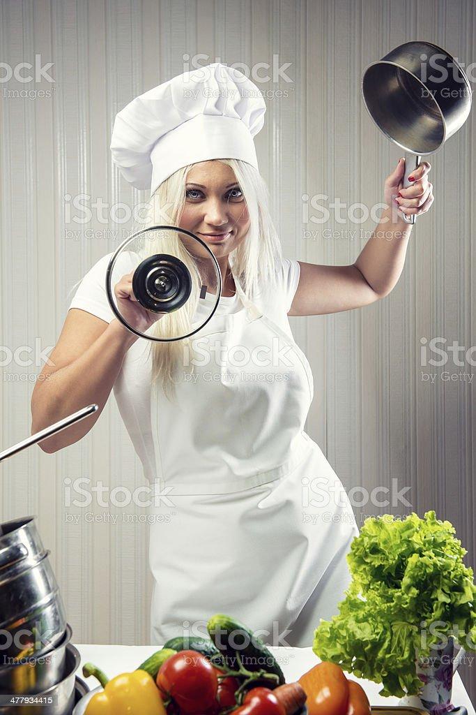 Woman cook wearing uniform posing indoors royalty-free stock photo