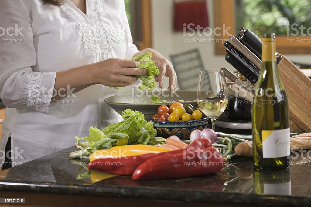 Woman Cooking and Preparing Healthy Food in Home Kitchen royalty-free stock photo