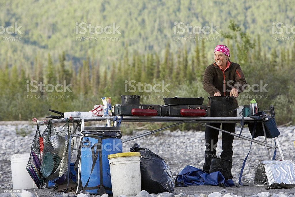 woman cooking at campsite foto stock royalty-free