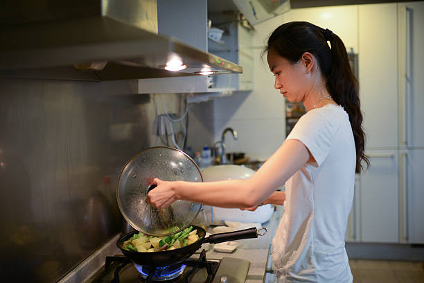 Woman Cooking At Home - XXXLarge stock photo