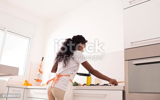 istock Woman cooking at kitchen. 610865518