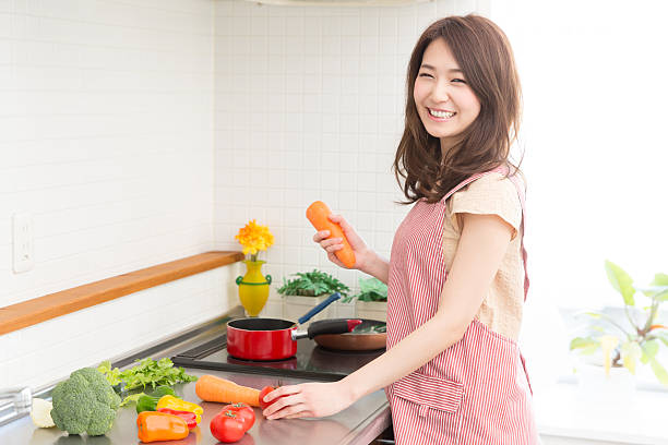 woman cooking in a kitchen - 料理 ストックフォトと画像