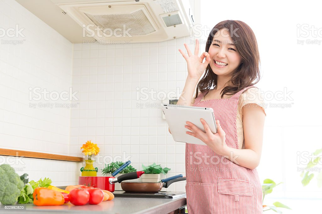 Woman cooking in a kitchen stock photo