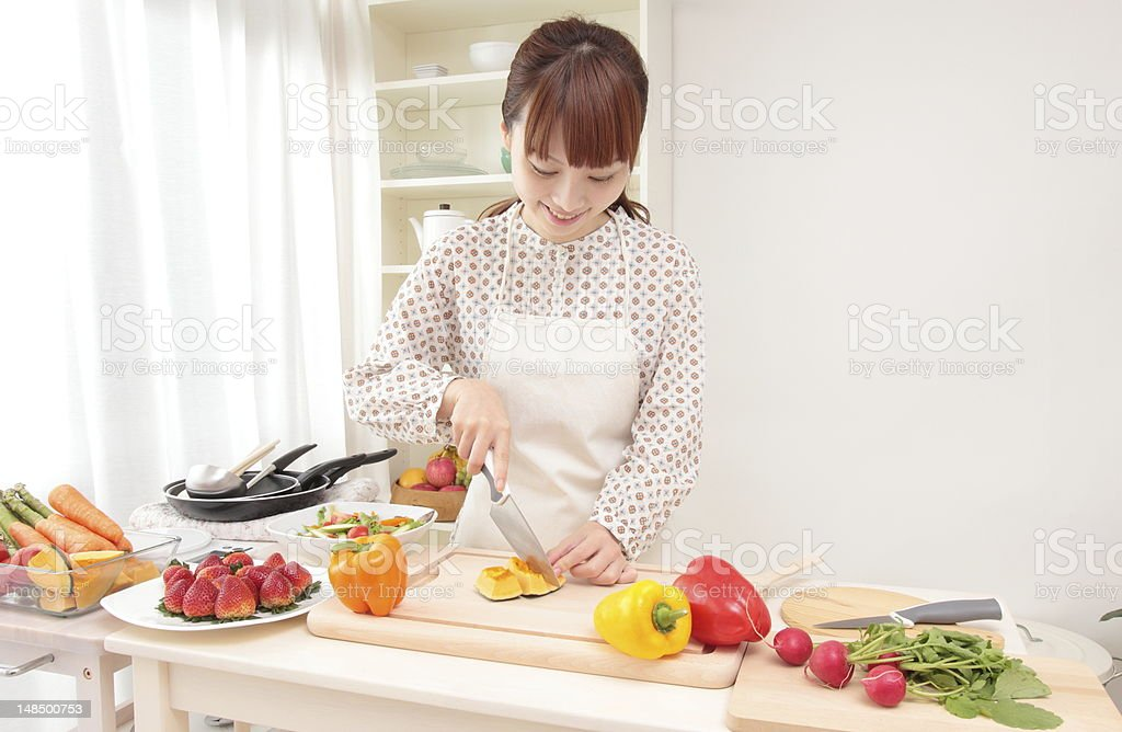 Woman cooking in kitchen royalty-free stock photo