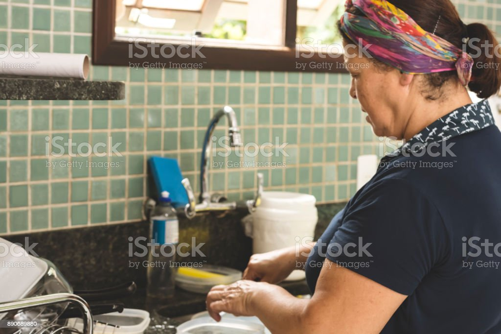 Woman cooking in the kitchen stock photo