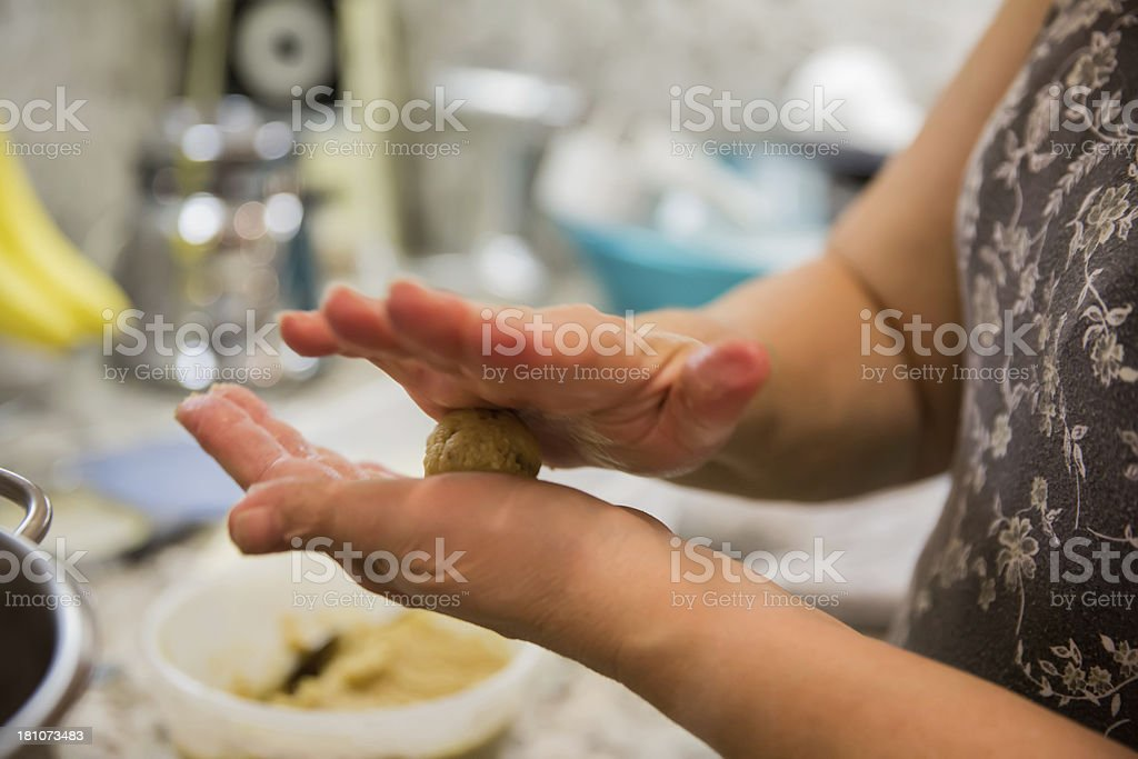 Woman cooking matzoh balls royalty-free stock photo