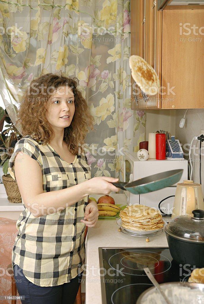 woman cooking pancakes royalty-free stock photo