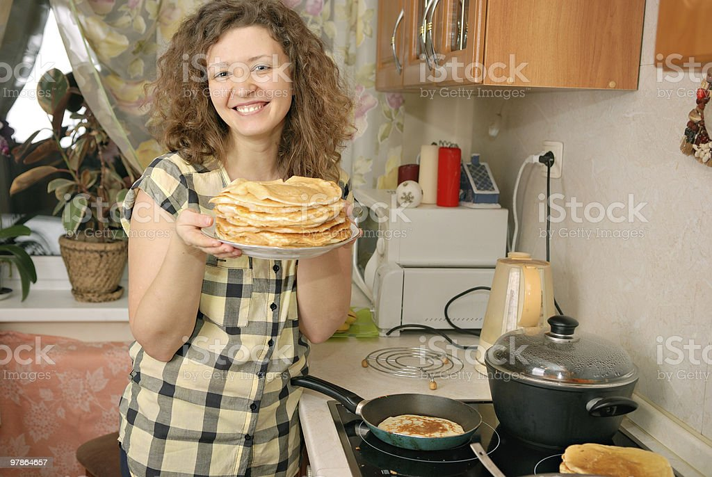 woman cooking pancakes stock photo