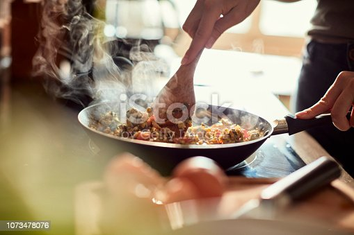 Close up of a young woman cooking