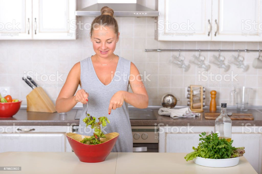 Woman cooking salad from fresh vegetable stock photo