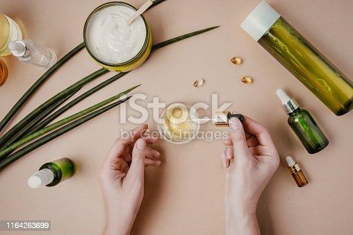 Organic, natural cosmetics. Natural shampoo, tonic, serum for hair and skin. Flat lay, minimalism pastel
