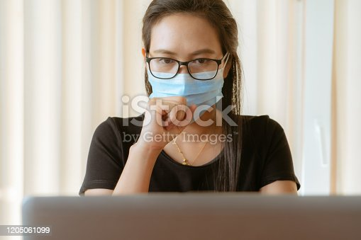 istock woman cough with face mask protection while working, Coronavirus, air pollution, allergy sick woman with medical mask 1205061099