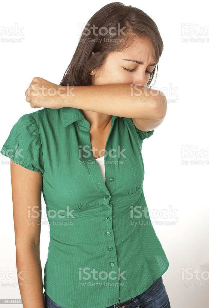 Woman Coughing into Elbow stock photo