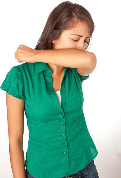 tosse donna in gomito - tossire foto e immagini stock