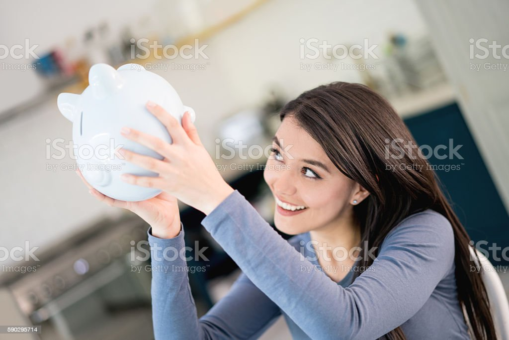 Woman counting her savings royaltyfri bildbanksbilder