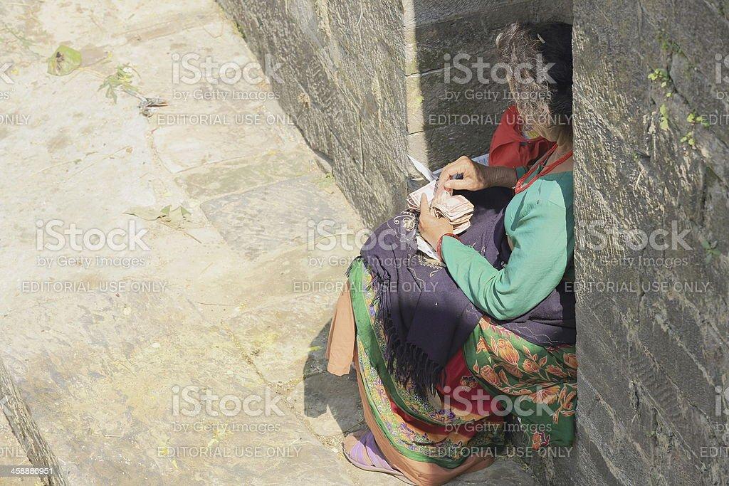 Woman counting money-Pashupatinath temple. Deopatan-Kathmandu-Nepal. 0290 stock photo