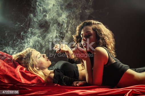 Woman Couple Smoking on the bed