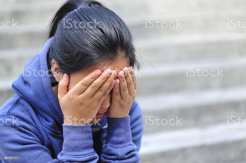 woman cover her face with hands royalty-free stock photo