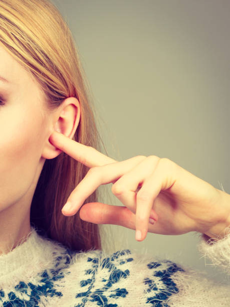 woman covering ears with fingers - stupidblonde stock pictures, royalty-free photos & images