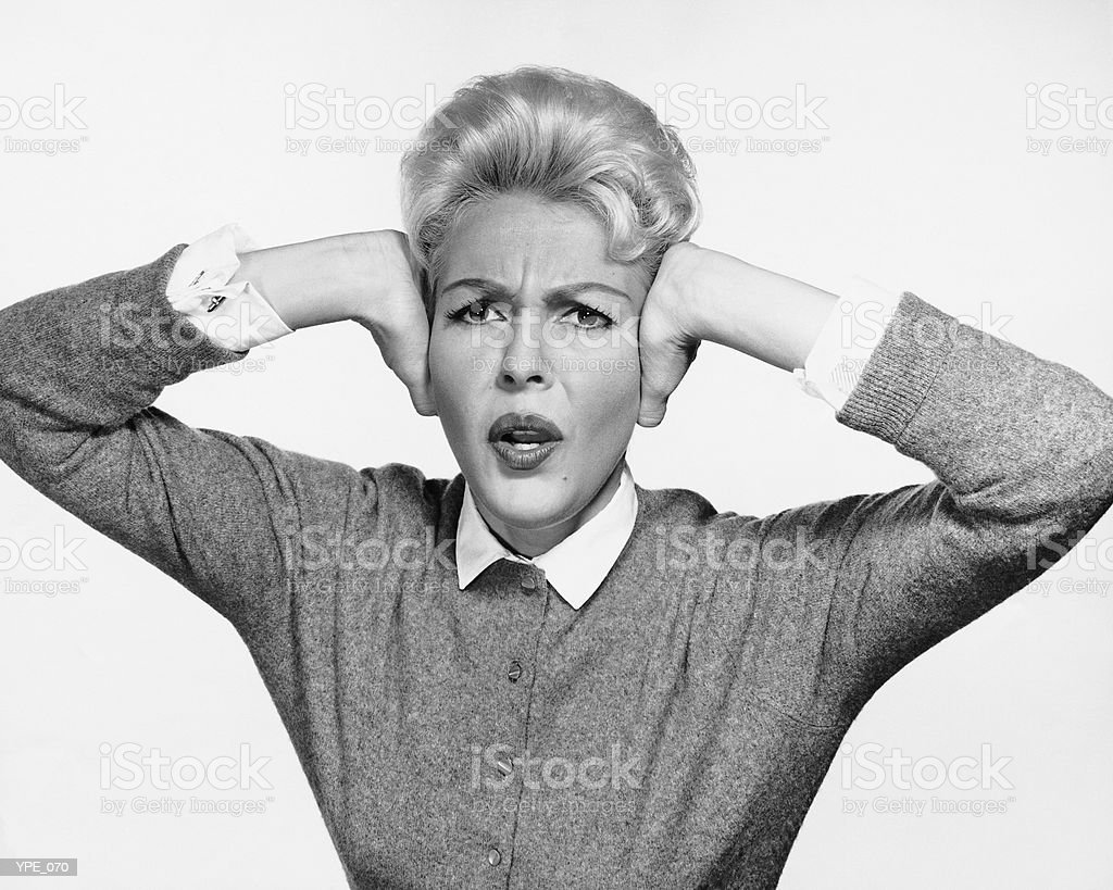 Woman covering ears with hands royalty-free stock photo