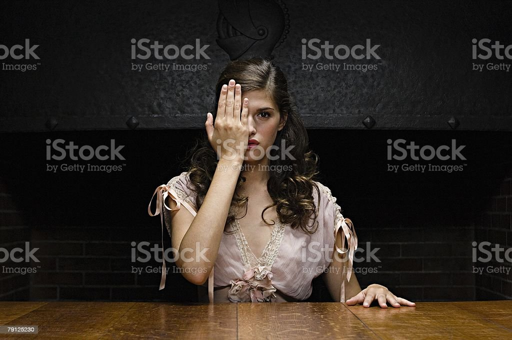 Woman covering her eye with hand 免版稅 stock photo