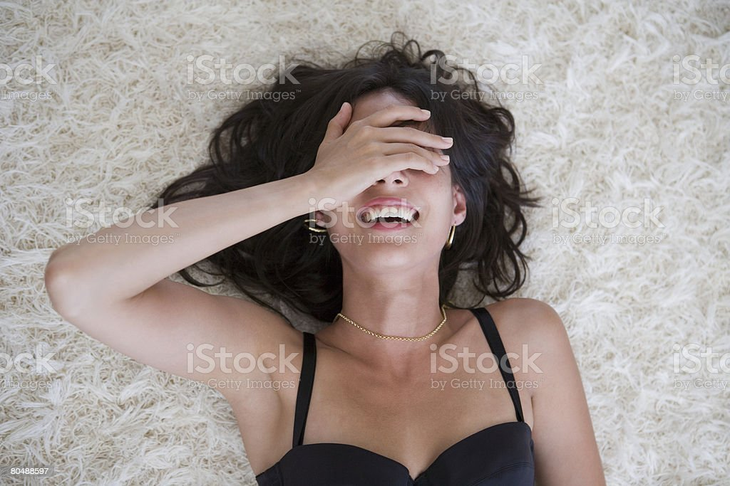 A woman covering her eyes 免版稅 stock photo