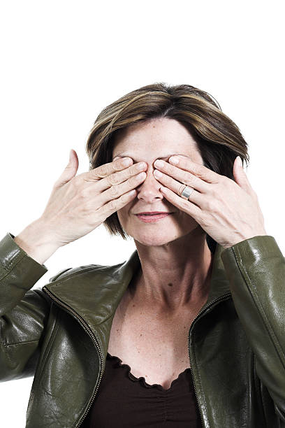 woman covering her eyes stock photo