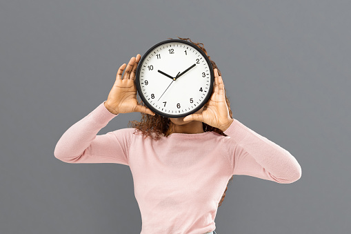 Woman Covering Her Face With Big Watch Stock Photo ...