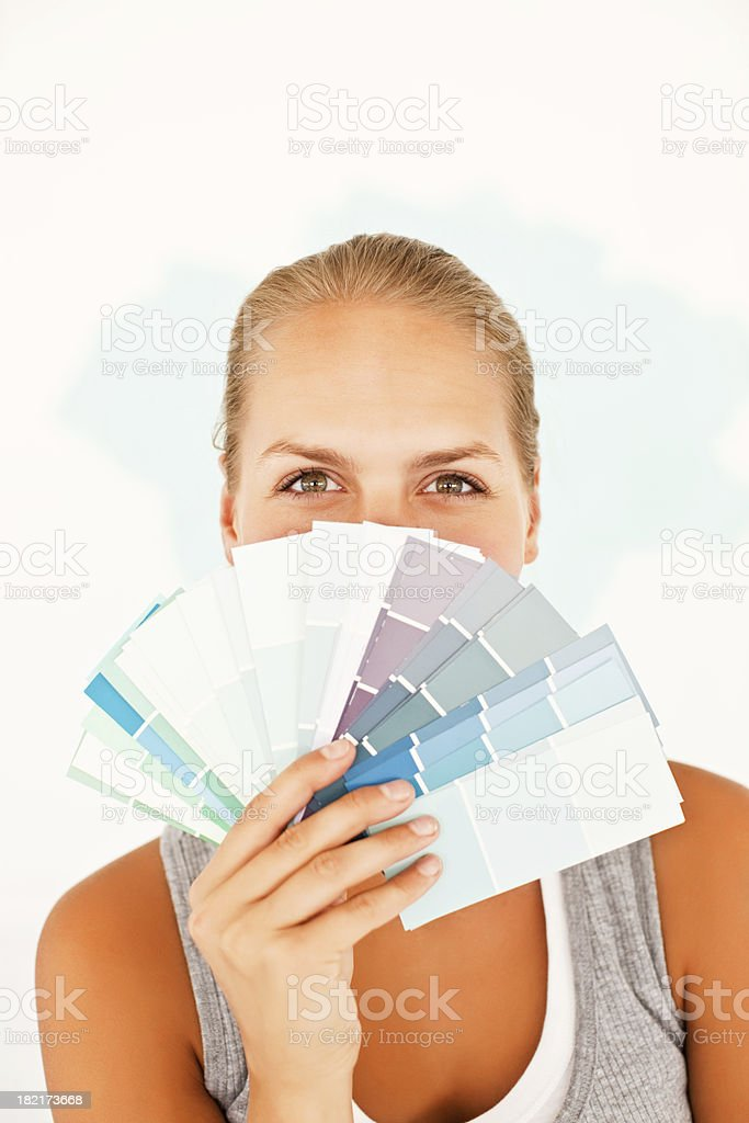 Woman covering her face with swatches stock photo